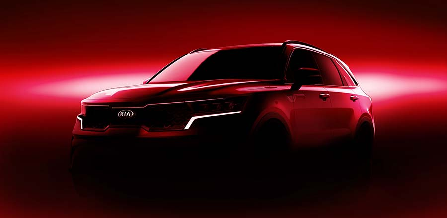 Click to enlarge image 01_kia_mq4_teaser_frt_red.jpg